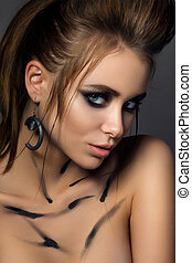 Beauty portrait of young glamorous woman with fashion make-up