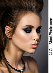 Beauty portrait of young glamorous woman with fashion hairdo