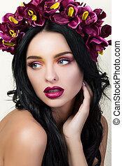 Beauty portrait of young pretty brunette girl with flower...
