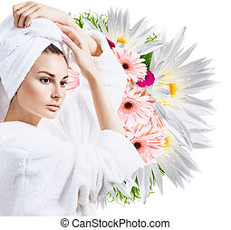 Beauty portrait of young woman in bathrobe.