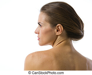 Beauty portrait of young woman looking on copy space . rear view
