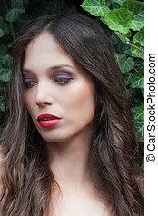 beauty portrait of young  woman outdoor in garden