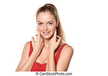 Beauty portrait of young woman touching face skin