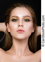 Beauty portrait of young woman with beautiful make-up