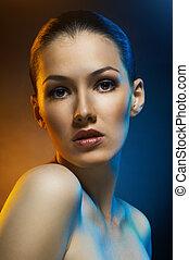 beauty portrait - a beauty girl on the dark background