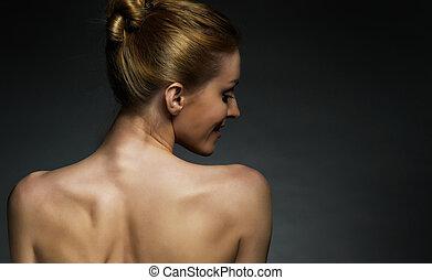 beauty portrait - Spin beautiful girls on a dark background