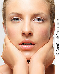 beauty portrait young woman touching her face