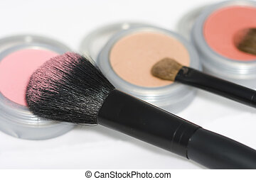 Beauty Products - Cosmetics and brushes isolated on white...