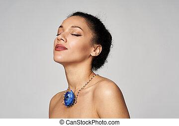 Beauty profile portrait of beautiful mixed race woman wearing chocker