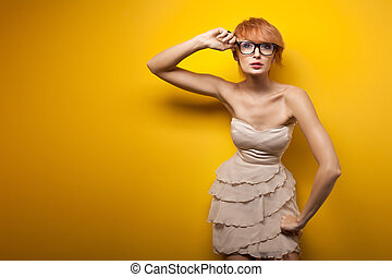 Beauty red haired woman wearing stylish glasses