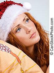 Beauty red woman in santa hat