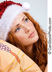 Beauty red woman in santa hat