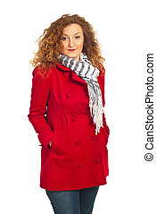 Beauty redhead woman in red jacket