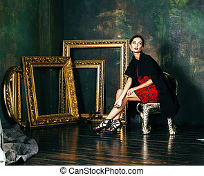 beauty rich brunette woman in luxury interior near empty...