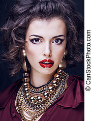 beauty rich brunette woman with a lot of jewellery, hispanic...