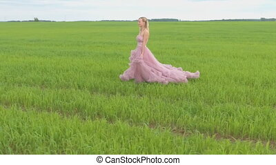 Beauty Romantic Girl standing in field