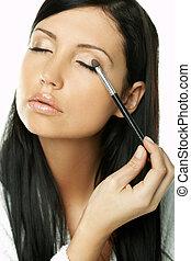 Beauty routines - Portrait of Beautiful brunette woman doing...
