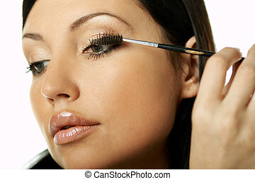 Beauty routines - Portrait of Beautiful brunette woman doing...