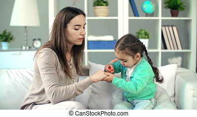 Beauty Salon Game - Toddler manicuring nails to her mother...