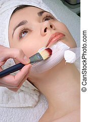 beauty salon series. facial mask applying