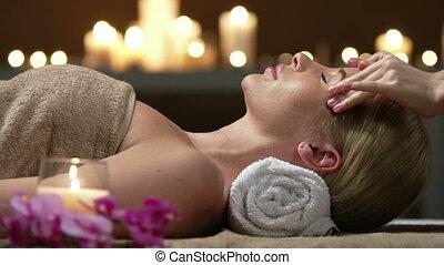 Beauty salon - Unrecognizable masseuse performing facial...
