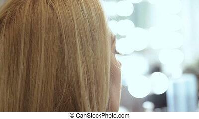 Beauty saloon Makeup artist paints lips lipstick blonde -...