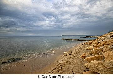 Beauty sea rocky coast with many stones on the shore. Black sea. Varna, Bulgaria