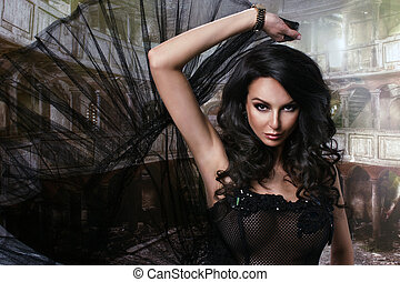 Beauty sensual woman in black dress