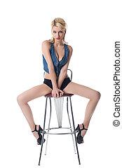 Beauty sexy woman posing on bar chair