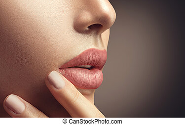 Beauty sexy woman with natural makeup and beige nail polish