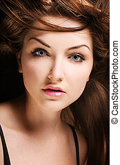 Beauty shot - A beauty shot of a young blue eyed woman with...