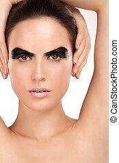 Beauty shot artistic smoky eye on beautiful model