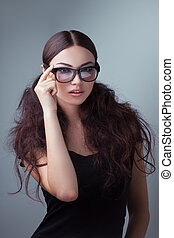 Beauty shot of a woman in stylish shades. - Fashionable ...
