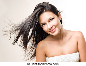 Beauty shot of brunette with flowing hair.