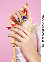 Beauty shot of model wearing colorful nail polish