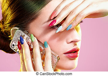 Beauty Shot Of Model Wearing Colorful Nail Polish On Pink