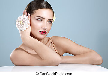 beauty shot of smiling woman with flowers accessories