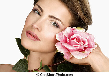 Beauty shot of woman with a beautiful rose