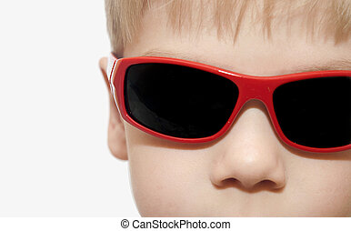 Beauty smiling child boy in sunglasses white isolated