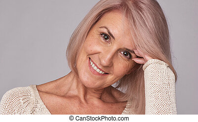 Beauty smiling mid aged woman with natural make up. Isolated...