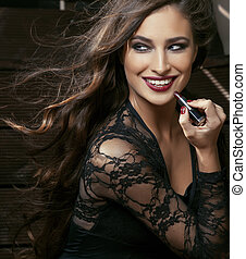 beauty smiling rich woman in lace with dark red lipstick, flying hair close up