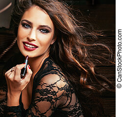 beauty smiling rich woman in lace with dark red lipstick