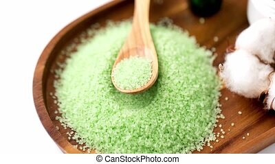 green bath salt with wooden spoon on tray - beauty, spa and ...