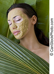 Beauty spa: Beautiful caucasian young woman with clay herbal...