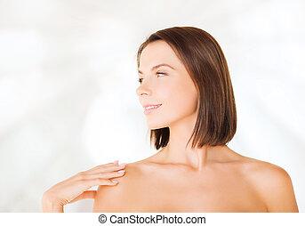 beautiful woman touching her shoulders - beauty, spa, health...