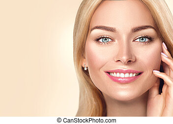 Beauty spa woman touching her face and smiling. Skincare concept