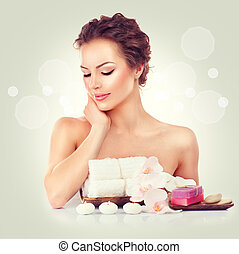 Beauty spa woman touching her soft skin