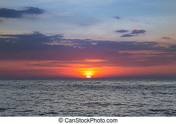 Beauty sunset over seacoast skyline