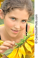 Beauty teen girl and sunflower