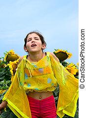 Beauty teen girl and sunflower